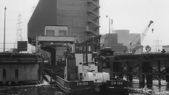 1969 montage transporting coal by barge and pouring it from chutes / united kingdom - lastkahn stock-videos und b-roll-filmmaterial