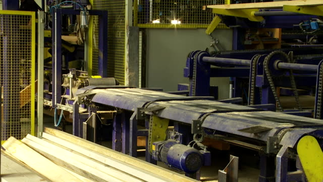 transporting planks on lumbermill production line - lumberyard stock videos and b-roll footage