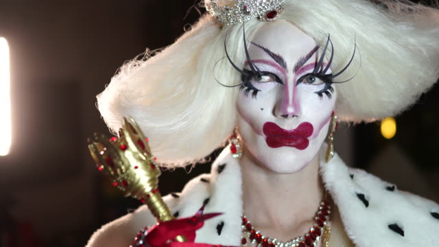 transsexual man with make-up in red dress sitting in dressing room - drag queen stock videos and b-roll footage