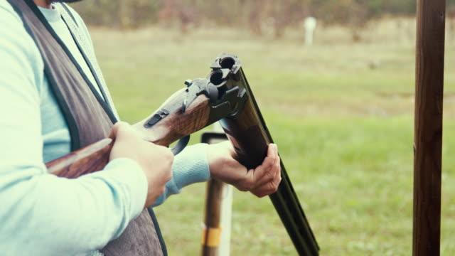 trap shooter reloading the shotgun - hobbies stock videos & royalty-free footage
