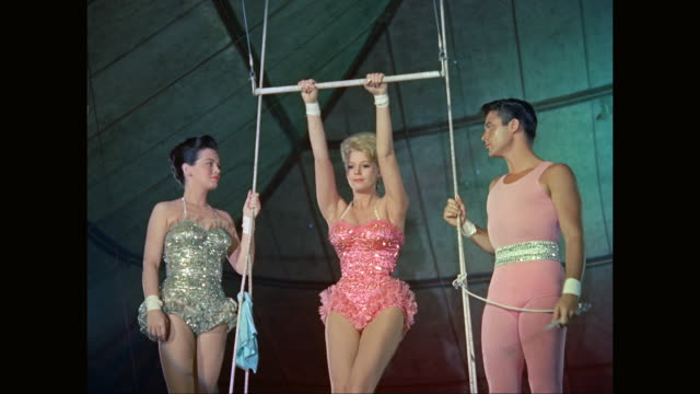 ms trapeze artists performing in circus / united states - レオタード点の映像素材/bロール
