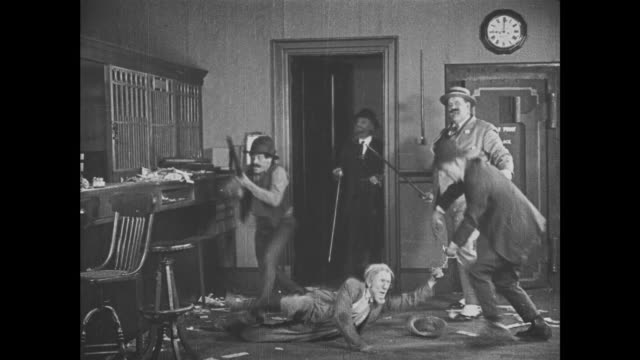 1921 Trapped by locked vault door, mistaken bank robber (Buster Keaton) is awoken by police and staff but escapes their grasp