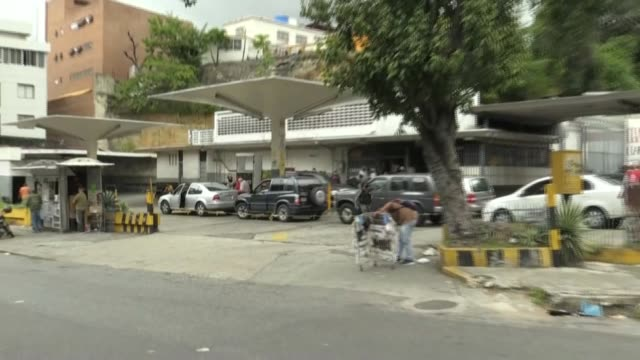 trapped in long lines for hours, caracas residents wait in front of gas stations to fill their tanks as fuel shortages persist in venezuela, as the... - caracas stock videos & royalty-free footage