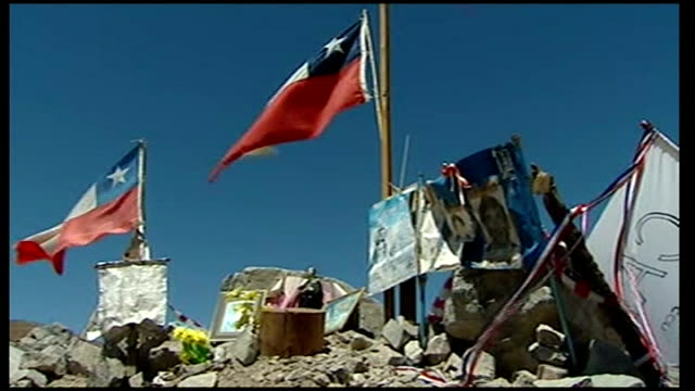 all thirty three miners safely rescued empty champagne bottle on ground in camp hope chile flags and banners in 'shrine' person waving banner from... - trapped stock videos & royalty-free footage