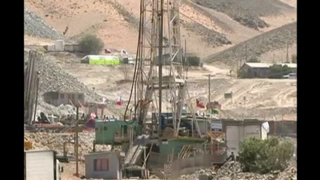 trapped miners dig for copper and gold while awaiting rescue via reuters ext general views copper and gold mine showing rescue shafts drilling... - chile stock-videos und b-roll-filmmaterial