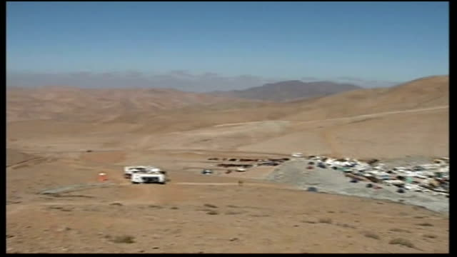 final preparations for rescue chile copiapo ext pan across desert landscape and san jose mine workmen at plan b shaft head - mine shaft stock videos and b-roll footage