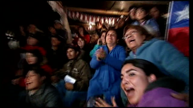 trapped miners rescued one by one after 69 days underground chile copiapo camp hope throughout*** close shots of women relatives looking celebrating... - minatore video stock e b–roll