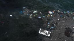 Trash and garbage floating on the surface of the water. Water pollution with dirty and plastic garbage floating on the surface of the sea