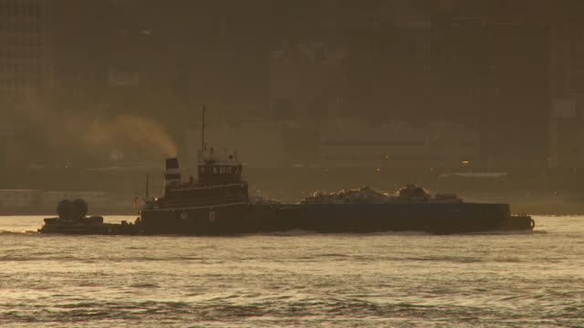ws ts trash barge with smoke stack, steaming down the hudson river / new york city, new york, usa - barge stock videos & royalty-free footage