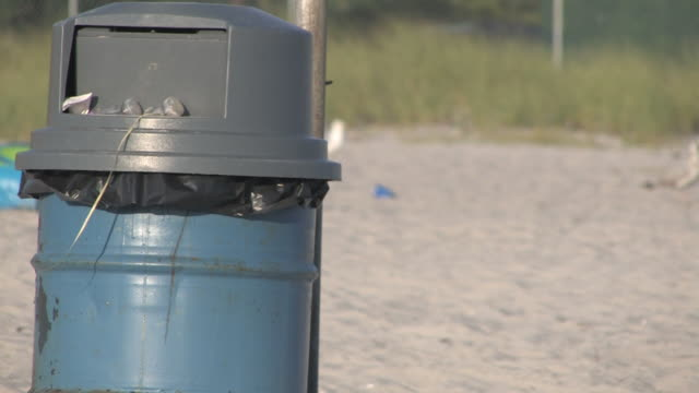 trash can at the beach - hd 30f - tin can stock videos & royalty-free footage