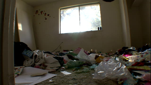 trash covers the floor of a vacant bedroom. - unhygienic stock videos & royalty-free footage