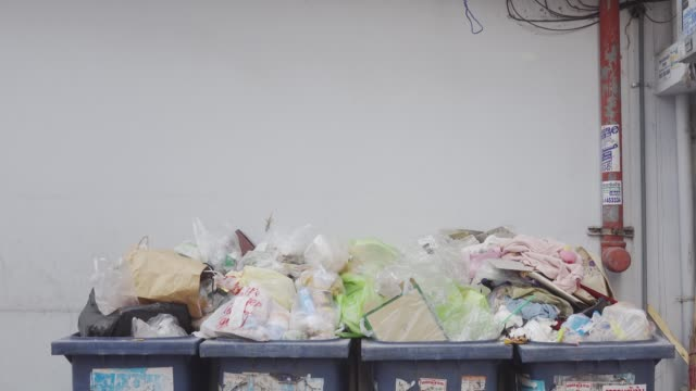 trash is full, discarded without separating the trash. - waste management stock videos & royalty-free footage