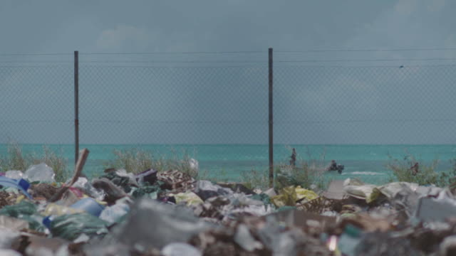trash site on tropical island. - pacific islands stock videos & royalty-free footage
