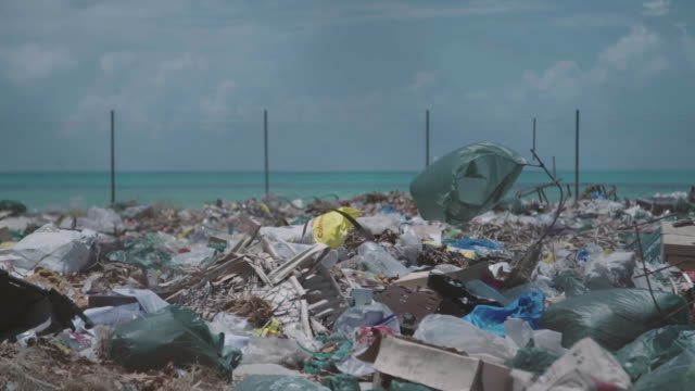 trash site on tropical island. - water pollution stock videos & royalty-free footage