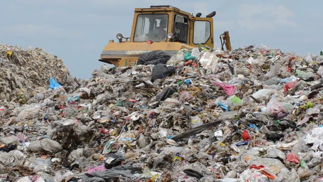 vídeos y material grabado en eventos de stock de poner verde - máquina excavadora