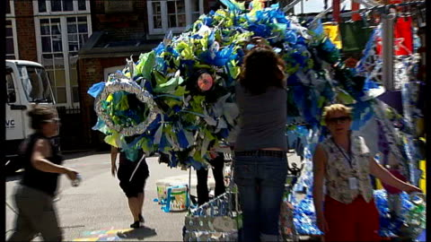 trashcatchers' carnival in south london; england: south london: tooting: ext various shots carnival floats made from recycled rubbish, including... - sachet stock videos & royalty-free footage