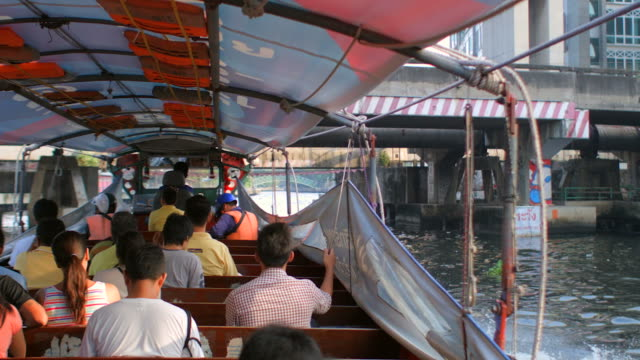 travel along canal in bangkok by water taxi - water taxi stock videos & royalty-free footage