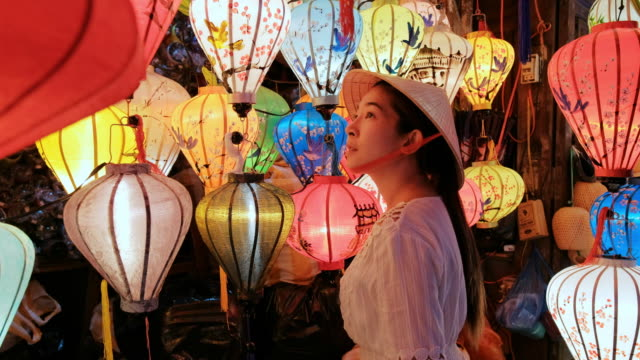 travel asian woman choosing lanterns in hoi an , vietnam - vietnam stock videos & royalty-free footage
