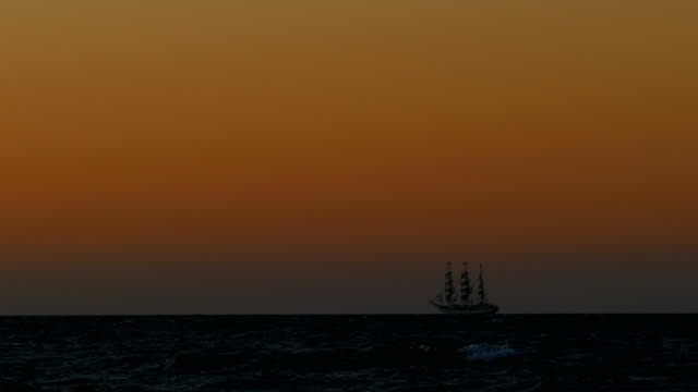 travel background - Tall ship at sunset