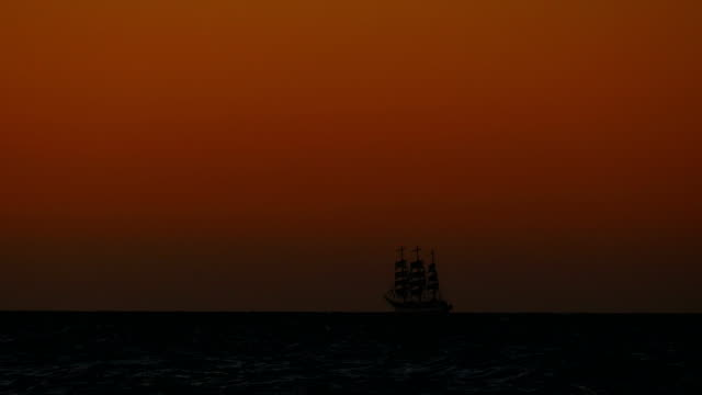 travel background - vintage Tall ship under sail at sunset