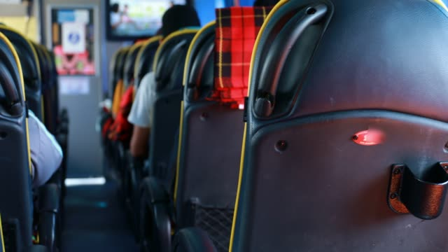 travel bus interior seats while bus is running - tour bus stock videos and b-roll footage