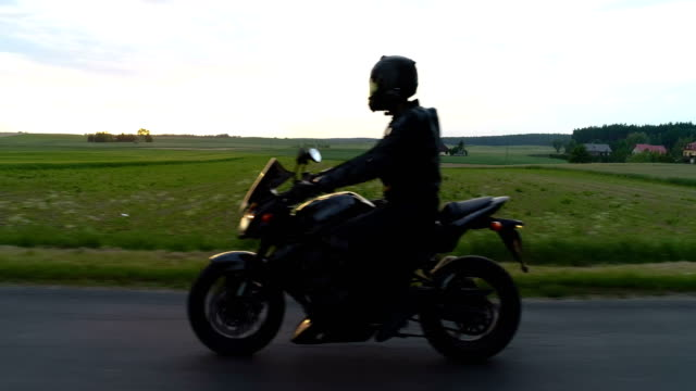 travel by motorcycle. rural landscape, close up - profilo vista laterale video stock e b–roll