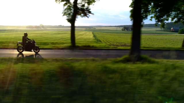 travel by motorcycle. rural landscape during sunset - motorbike stock videos & royalty-free footage