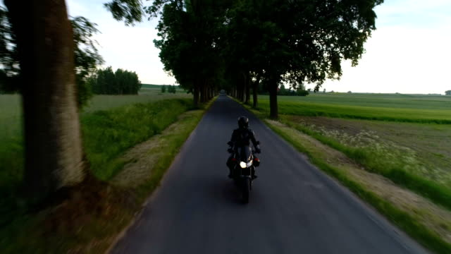 travel by motorcycle. rural landscape - motorbike stock videos & royalty-free footage