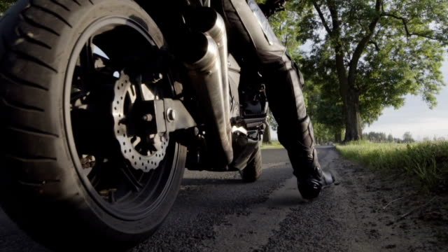 travel by motorcycle. vehicle details. rural landscape - leather jacket stock videos and b-roll footage
