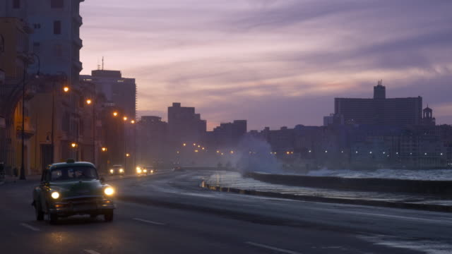 travel cinemagraph, havana malecon at dusk - cuba stock videos & royalty-free footage