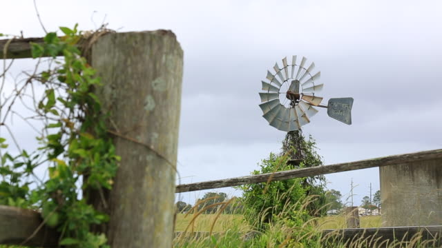 travel cinemagraph of an old windmill moving with the wind - mill stock videos & royalty-free footage