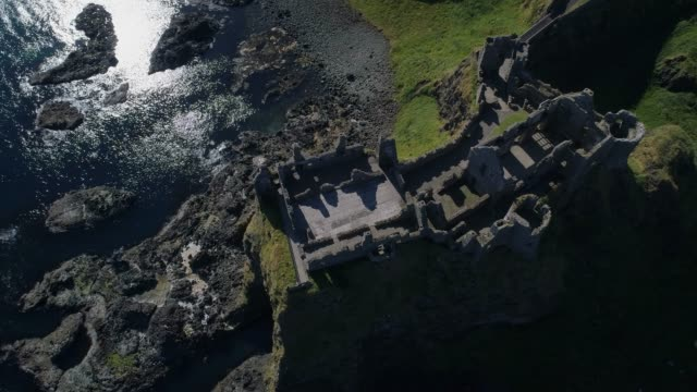 travel cinemagraphs, aerial view of dunluce castle - castle stock videos & royalty-free footage
