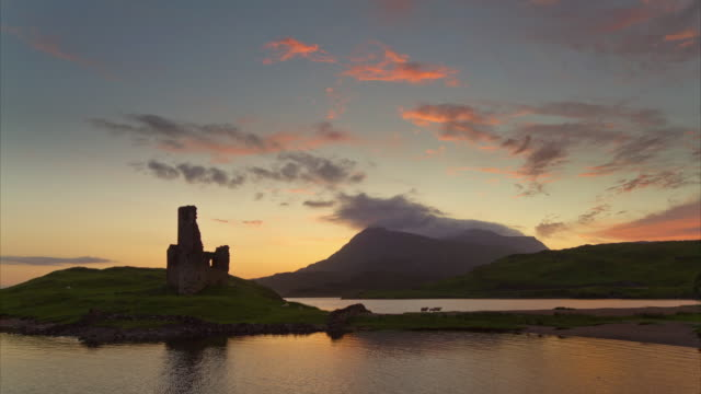 vidéos et rushes de travel cinemagraphs, ardvegh castle at sunset - écosse