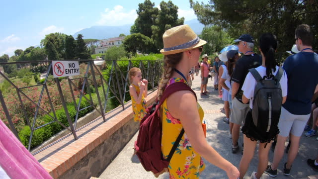 travel group guided tour bookshop sign in the ancient ruins sightseeing historic landmark of pompeii, italy, europe. - time-lapse - goodsportvideo stock videos and b-roll footage