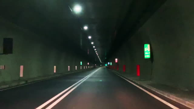travel in an illuminated tunnel - narrow stock videos & royalty-free footage