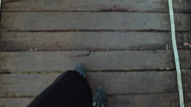 travel like a local - brief - feet of a woman walking in a historic timber bridge in yarra valley, melbourne, victoria - noelia ramon stock videos & royalty-free footage