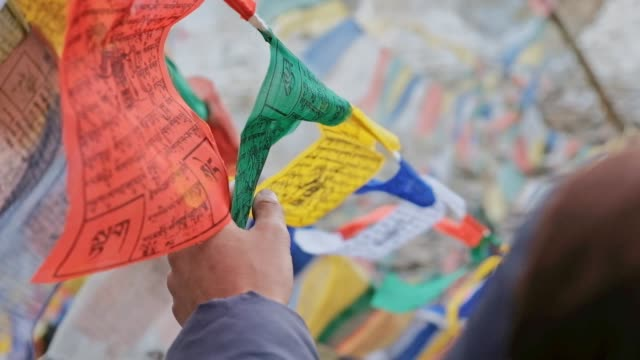 travel man and tibetan buddhism prayer flags leh ladakh,india - tibet stock videos & royalty-free footage