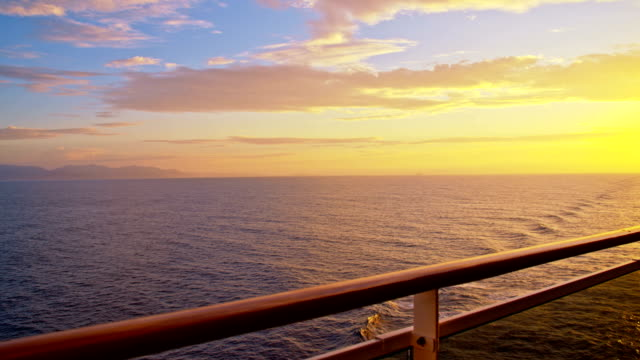 slo mo travel on the sea at sunset - cruise stock videos & royalty-free footage