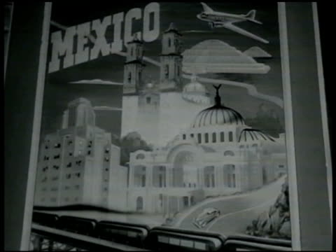 mexico travel poster for mexico people walking on town street w/ double spire church bg people tourists walking w/ standing merrygoround bg - 1949 stock videos & royalty-free footage