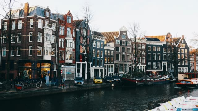 travel to amsterdam - famous streets and canals in dutch city - canal stock videos & royalty-free footage
