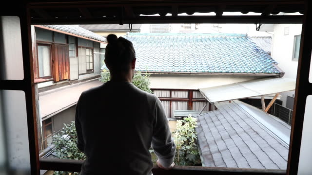 traveler admiring garden view in japanese home - ryokan stock videos and b-roll footage