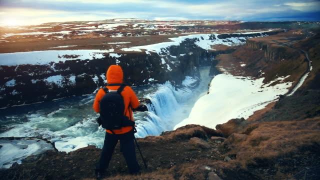 Traveler at Gullfoss Waterfall in Iceland