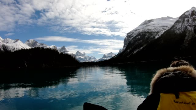 traveler canoeing on maligne lake into spirit island, jasper national park - using a paddle stock videos & royalty-free footage