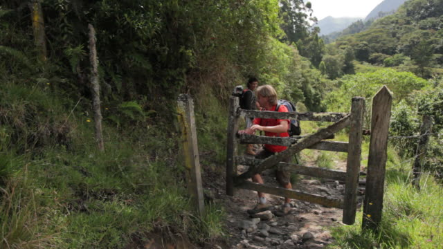 MS Traveler closing gate on rural path / Salento, Quindio, Colombia