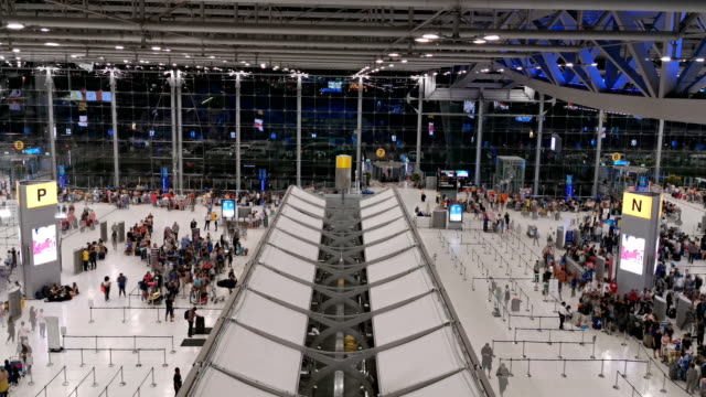 traveler crowd at airport check in counter hall - airport check in counter stock videos & royalty-free footage