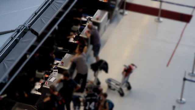 traveler crowd at airport check in counter. - airline check in attendant stock videos & royalty-free footage