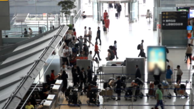 traveler crowd at airport check in counter. - airline check in attendant stock videos and b-roll footage