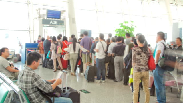 traveler crowd at airport gate before boarding time lapse - airline check in attendant stock videos and b-roll footage