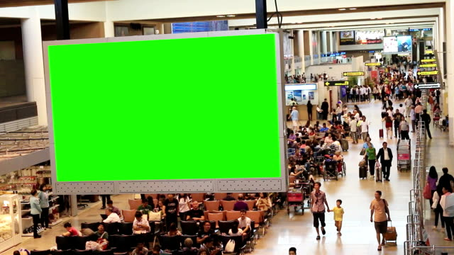 hd: traveler crowd at airport with green screen - corridor stock videos & royalty-free footage