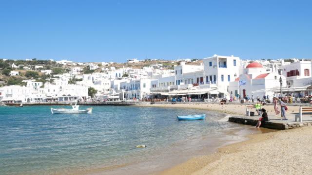 traveler crowd at town of chora on mykonos greece, 4k resolution. - mykonos stock videos & royalty-free footage